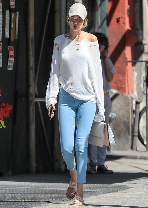 gigi hadid baseball cap a shoulder comfy sweater