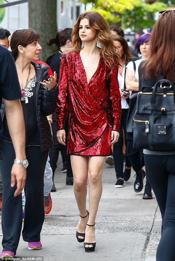 red sequin dress that throws the v-neck