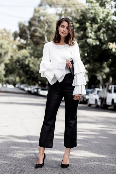 white ruffle sleeve top black dress pants