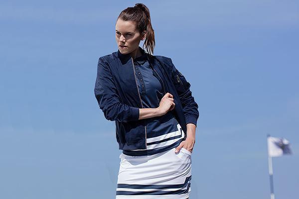 black bomber golf jacket with white mini skirt