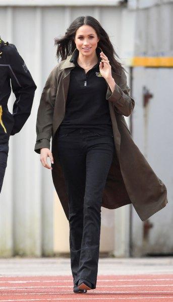 gray longline golf jacket with black skinny jeans