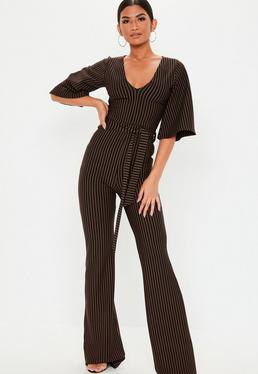 Black and white jumpsuit with vertical stripes and V-neck and wide sleeves