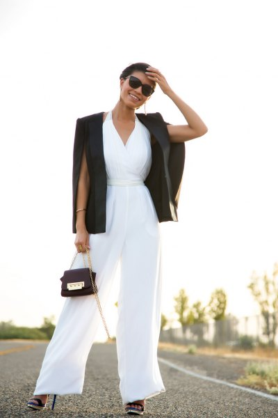 white jumpsuit with v-neck and flap with black blazer