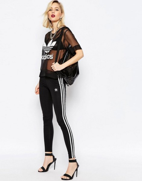 black semi-transparent top with adidas leggings and heels