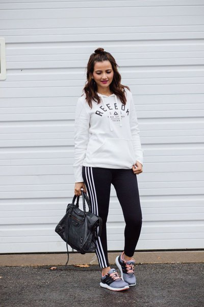 white hoodie with black and white adidas leggings
