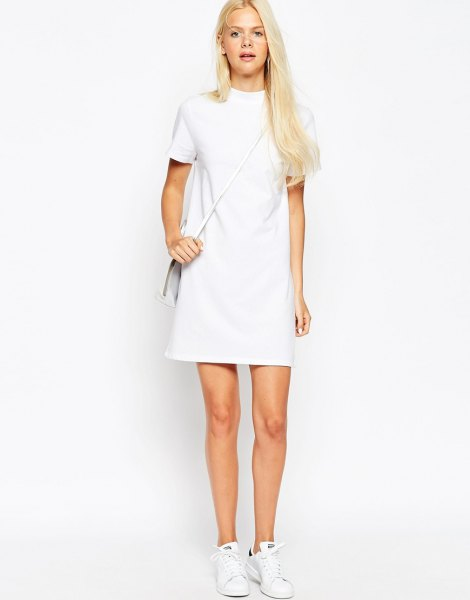 white short-sleeved mini dress with stand-up collar and sneakers