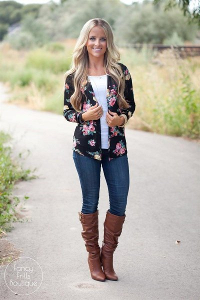 black and pink floral jacket with dark blue skinny jeans