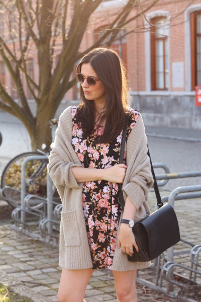 blushing pink cardigan with black flower mini dress
