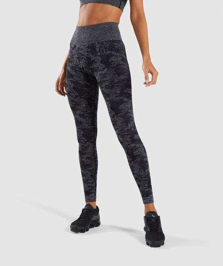 black crop top with gray printed leggings and sneakers