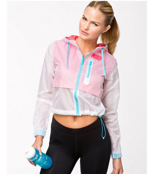 short running jacket in white and baby blue with black jogging tights