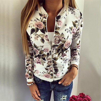 white running jacket with floral pattern and blue ribbed skinny jeans