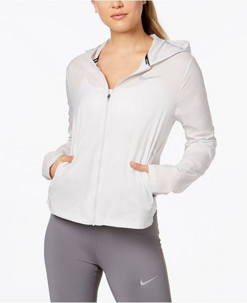 white running jacket with gray tights