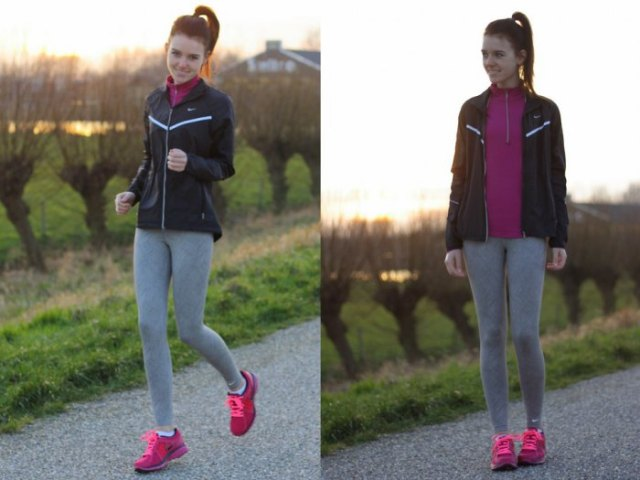 black running windbreaker with gray leggings and pink sneakers
