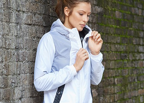 white and gray black running jacket with black tights