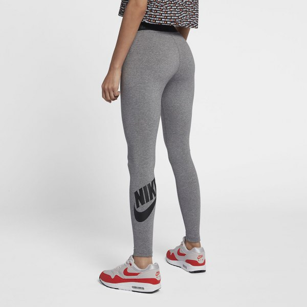 gray and black printed short t-shirt with high-waisted Nike leggings