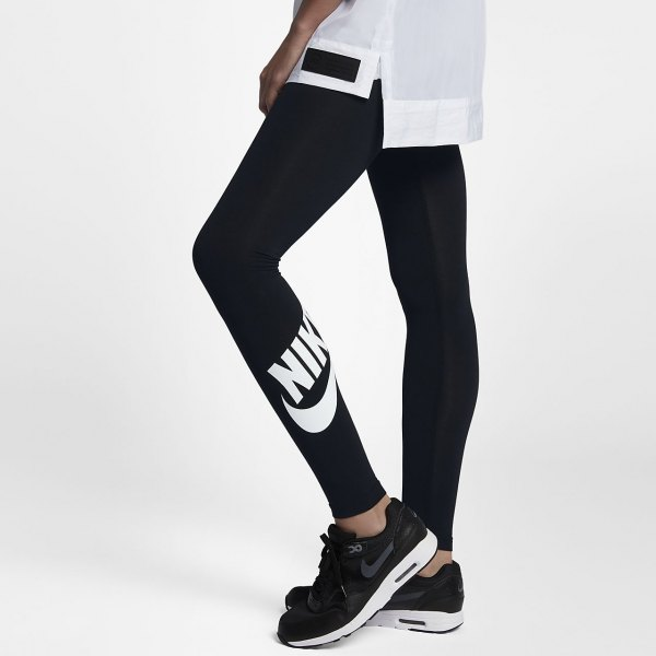 white oversized sports t-shirt with black high-waisted Nike leggings