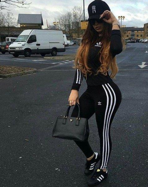 black baseball cap with windbreaker and adidas running pants