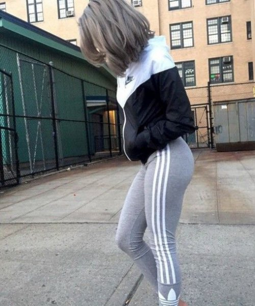 Black and white color block windbreaker with gray running pants