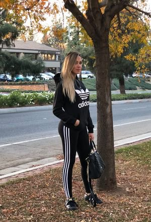 black hoodie with running gaiters and sneakers