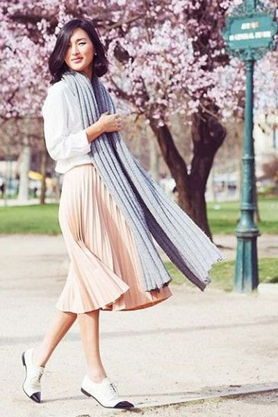 white sweatshirt with light pink pleated midi dress and oxfords