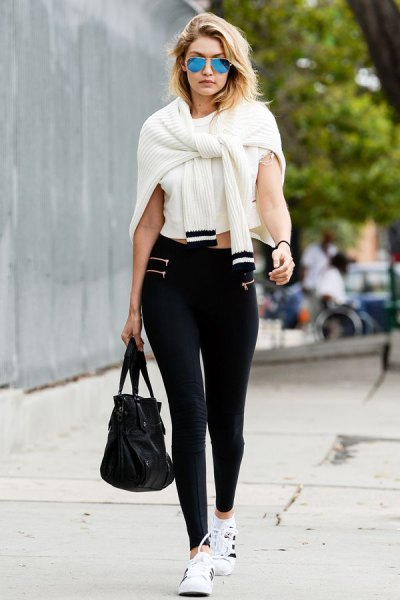 white short t-shirt with a ribbed cardigan and black high-rise gaiters