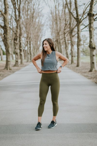 gray, short tank top with green, high-waisted leggings