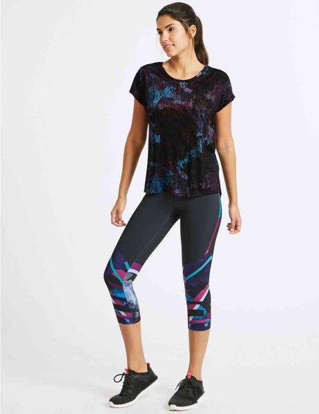 black printed t-shirt with colorful, short cut leggings