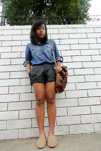 light blue chambray shirt with black mini shorts