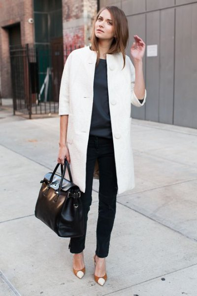 white long wool coat with black chinos and red toe heels
