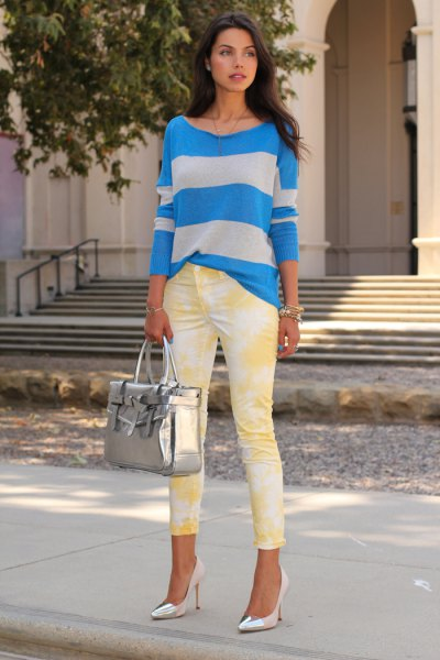 blue-gray striped sweater with yellow printed skinny jeans