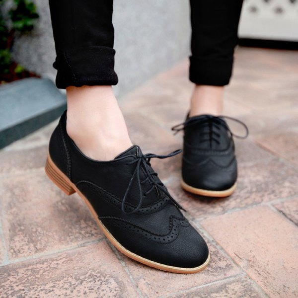 black skinny jeans with cuffs and matching suede wingtip shoes
