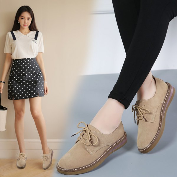 white blouse with black dotted mini skirt and light suede shoes made of camel