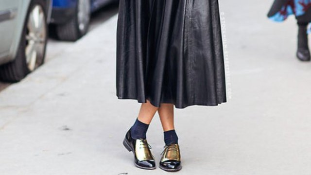 black leather maxi dress with pleated, gray crew socks and gold derby shoes