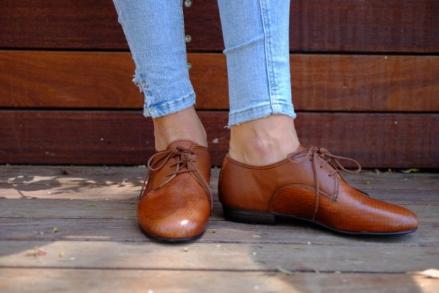 light blue jeans with brown leather oxford shoes