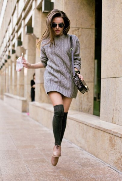 gray knitted sweater dress with stockings and light brown leather shoes