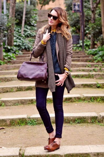 gray cardigan with dark blue sweater and dark skinny jeans