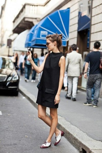 black mock-neck mini dress with white and gray oxford evening shoes
