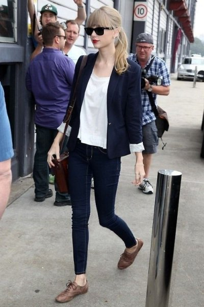 Navy blue blazer with white chiffon blouse and gray oxford evening shoes