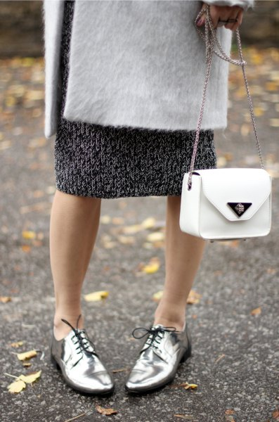white wool coat with black printed midi shift dress and silver evening shoes