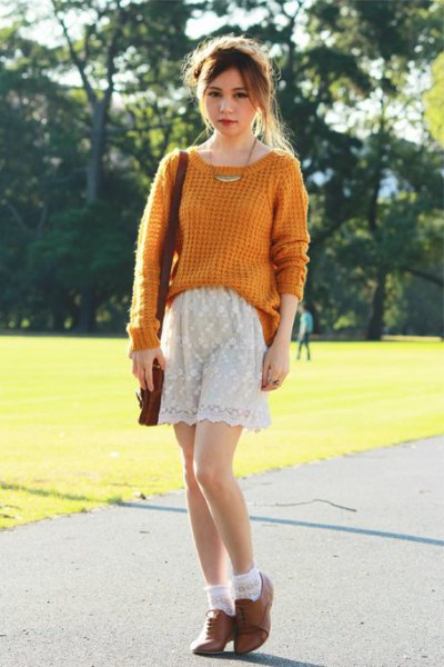green, knitted sweater with white lace shorts and brown oxford suede shoes