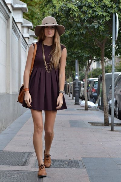 black sleeveless, flaky mini dress with brown oxford shoes