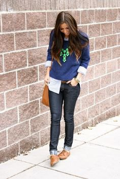 Dark blue knit sweater with black skinny jeans and brown shoes