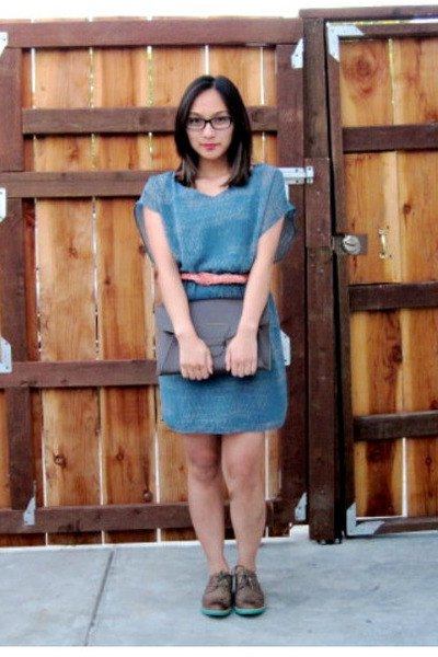 blue denim mini dress with scoop neck and wingtip shoes made of brown leather