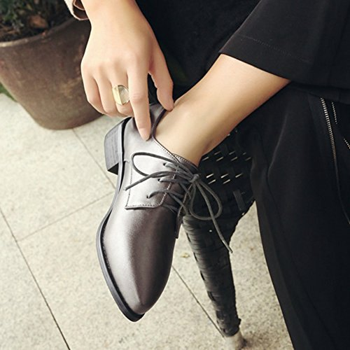 dark high-heeled leather shoes with black chinos with straight legs