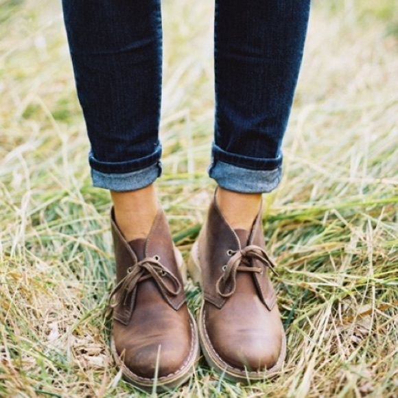 Dark blue jeans with cuffs and brown leather shoes