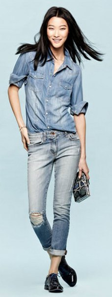 Chambray shirt with blue torn jeans with cuffs