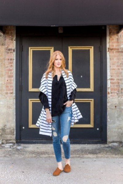 blue and white striped oversized cardigan with torn jeans and brown suede shoes