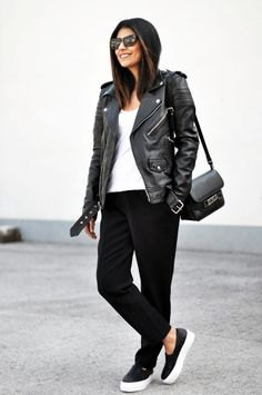 Moto jacket with slim jeans and black leather sneakers
