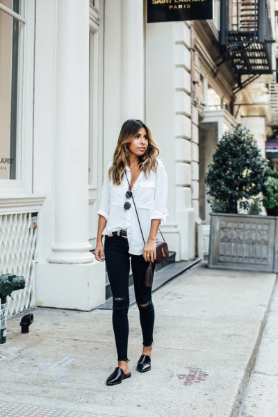 white linen shirt with buttons, torn skinny jeans and black leather shoes