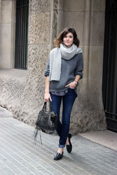 gray, chunky sweater with knitted scarf and jeans with cuffs